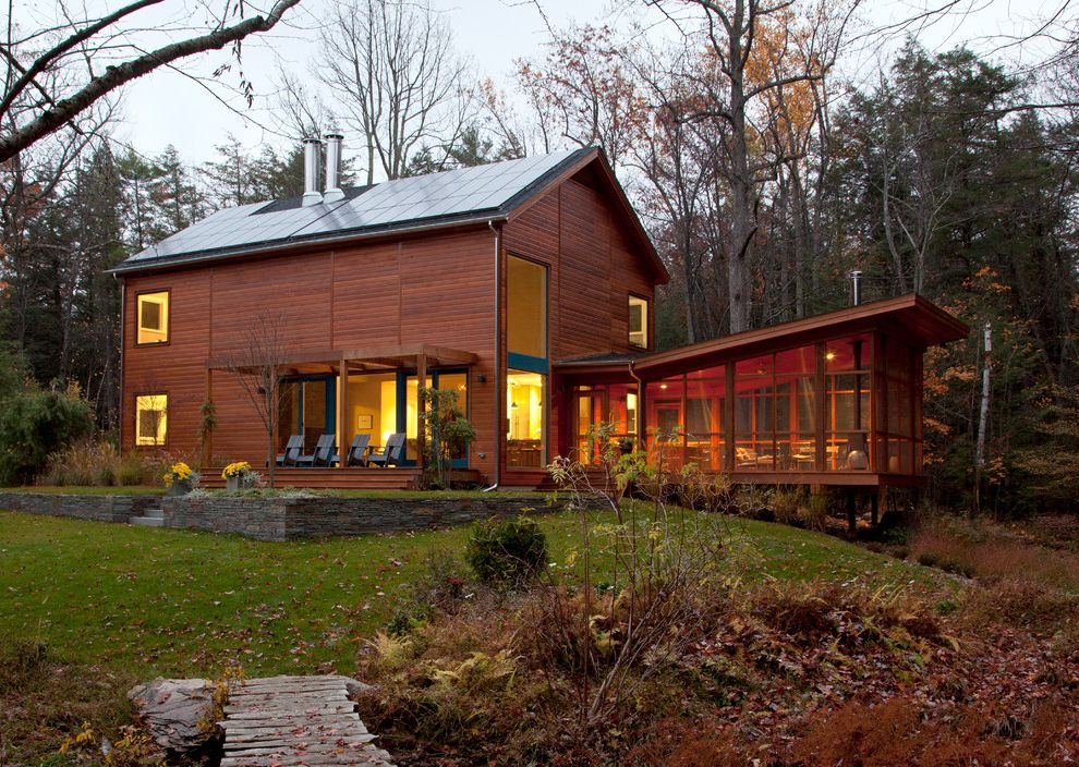 Annapolis Property Services with Contemporary Exterior  and Cedar Siding Entry Modern Cabin Natural Landscape Pipe Chimney Plants Screened Porch Slatted Wood Solar Solar Panels Steps Trees Two Story House Walkway Windows Wood Cladding Wood Siding