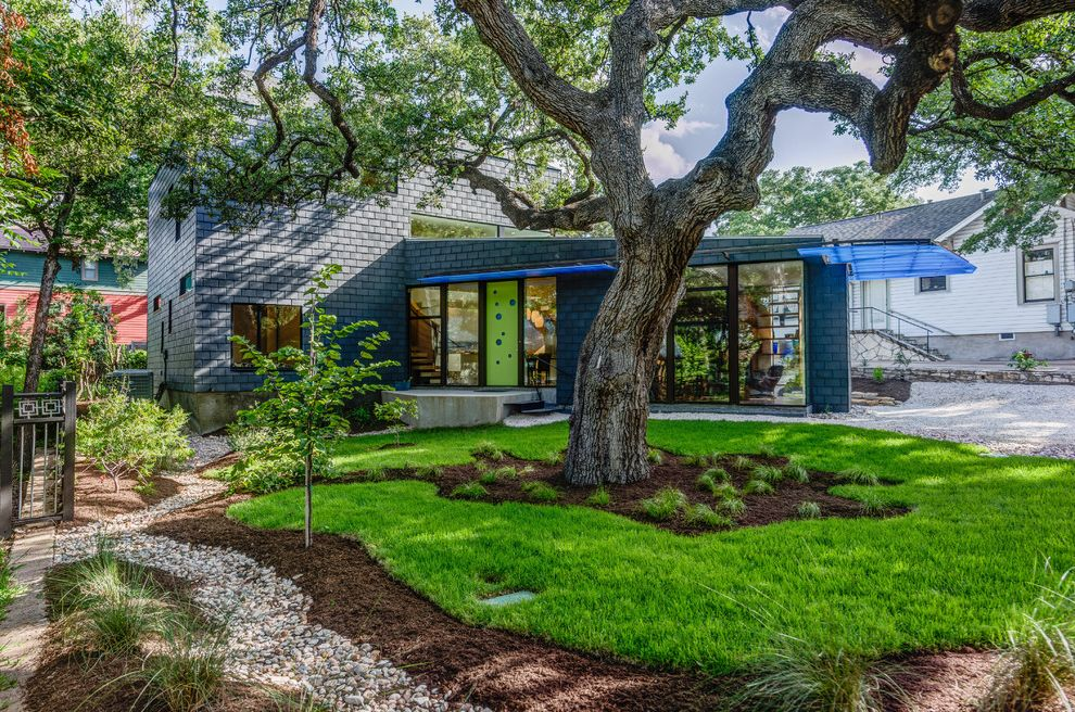 Annies Austin with Contemporary Exterior  and Concrete Block Driveway Dry Creek Entry Grass Mulch Oak Tree Overhang Pebbles Sidewalk Xeriscape