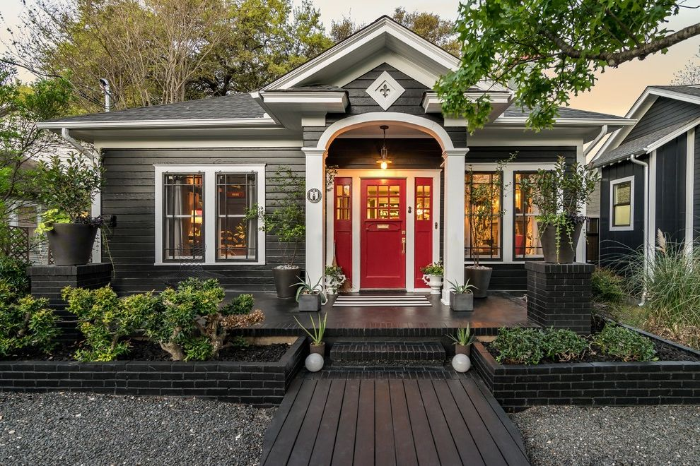 Annies Austin with Traditional Exterior Also Address Numbers Archways Austin Black and White House Custom Builder Entry Gravel Painted Brick Plants Porch Red Door Retainer Walls Side Light Sidelight Steps White Trim Windows