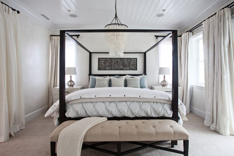 Beachy Bedding with Beach Style Bedroom Also Beachy Home Beadboard Ceiling Canopy Bed Capiz Shell Chandelier Coastal Interiors Tufted Bench White Curtains