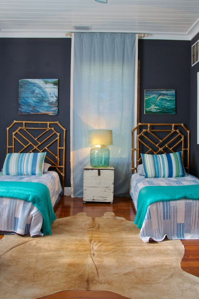 Beachy Bedding with Beach Style Bedroom  and Animal Skin Rug Bamboo Bedframes Blue Bedding Distressed Paint Eclectic Rustic Southern Charm Tongue and Groove Ceiling Two Twin Beds