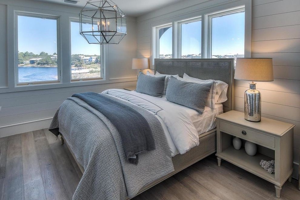 Beachy Bedding with Beach Style Bedroom  and Beach Style Bedside Table Chrome Table Lamp Distressed Glass Pendant Light Guest Room Light Wood Floors Mesh Headboard Neutral Sand Blown Shiplap Water View