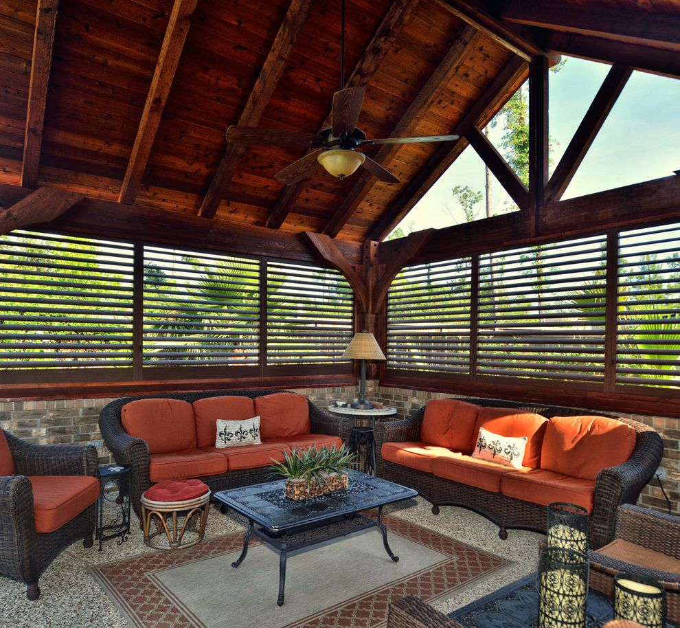 Budgetblinds   Rustic Sunroom Also Gray Floors Indoor Ceiling Fan Orange Cushions Wicker Sofa Wood Ceiling Fan Wood Shutters