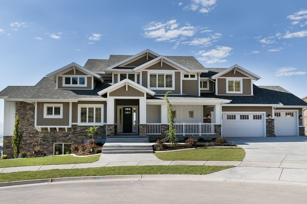 Caliber Home Loans Reviews   Craftsman Exterior  and Cape Cod Style Concrete Driveway Dormer Windows Entrance Entry Entry Porch Front Door Grass Lawn Porch Shingle Siding Sidewalk Turf White Trim Wood Siding