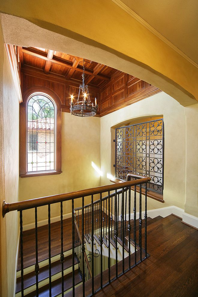 Capital Iron Works   Mediterranean Staircase  and Baseboards Coffered Ceiling Dark Floor High Ceiling Leaded Glass Metal Banister Ring Chandelier Spanish Colonial Stained Glass Textured Walls Tradtional White Wood Wood Ceiling Wood Flooring Wood Molding