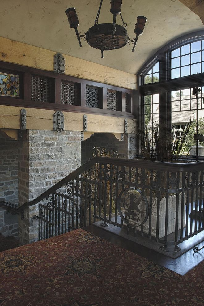 Capital Iron Works with Traditional Staircase Also Arched Windows Carpeting Iron Cleats Iron Railing Stained Glass Stone Wood Beams