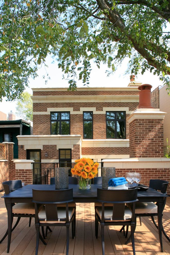 Chimney Sweep Kansas City   Traditional Patio  and Brick Chimney Dark Stained Wood Dark Trimmed Windows Lattice Limestone Narrow Windows Outdoor Dining Outdoor Entertaining Patio Porch Seat Cushions