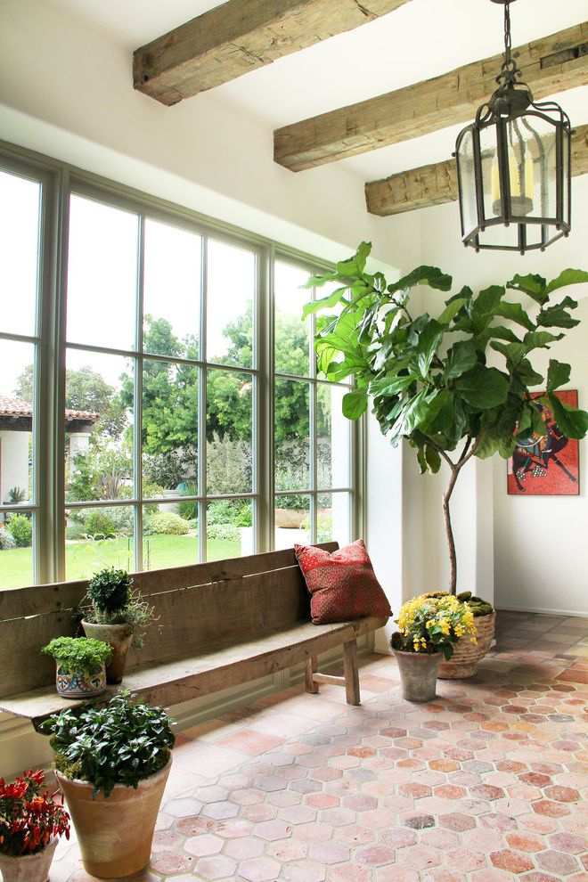 City Lights on Fig with Mediterranean Entry Also Antique Bench Antique Terra Cotta Beams Hexagonal Tile Houseplant Lantern Potted Plant Potted Plants Spanish Colonial Terracotta Tiles Tomettes Wood Bench