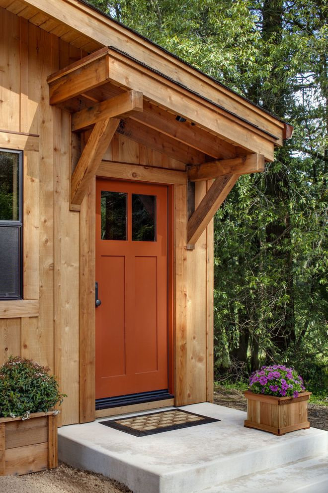 Codel Doors   Contemporary Entry Also Concrete Patio Orange Front Door Outdoor Potted Plant Purple Flowers Wood Corbel Wood Exterior Wood Siding