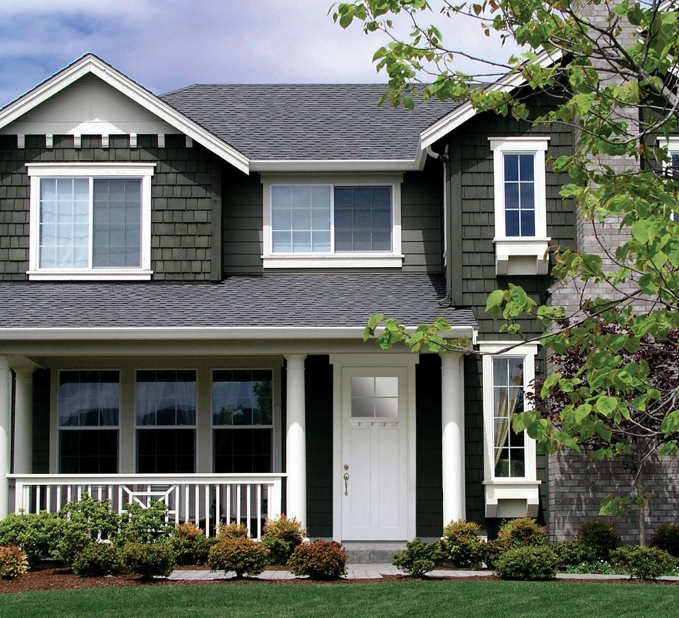 Codel Doors with  Entry  and Bay Windows Front Doors Pillars Roof Roofing Gutters Roofline Shingle Siding White Window Trim