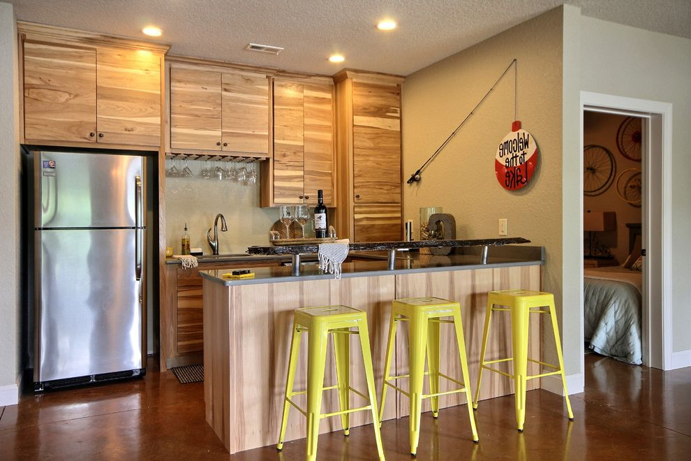 Concrete Floors for Homes   Rustic Basement  and Basement Kitchen Beige Wall Concrete Floor Home Bar Polished Concrete Floor Raised Counter Raised Countertop Recessed Lighting Wood Cabinets Wood Drawers Yellow Bar Stool
