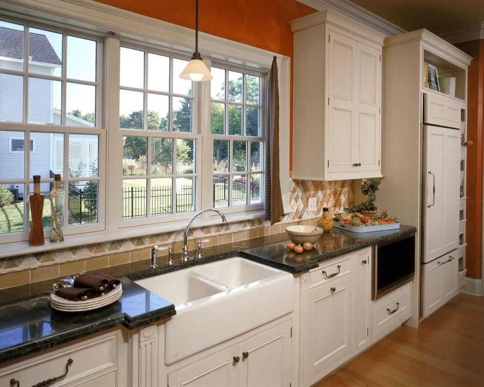 Cost of Farmhouse Sink with Traditional Kitchen Also Cabinet Details Cabinet Front Fridge Farmhouse Sink Granite Counters Hardwood Floors Orange Panel Refrigerator Tile Backsplash White Cabinets Windows