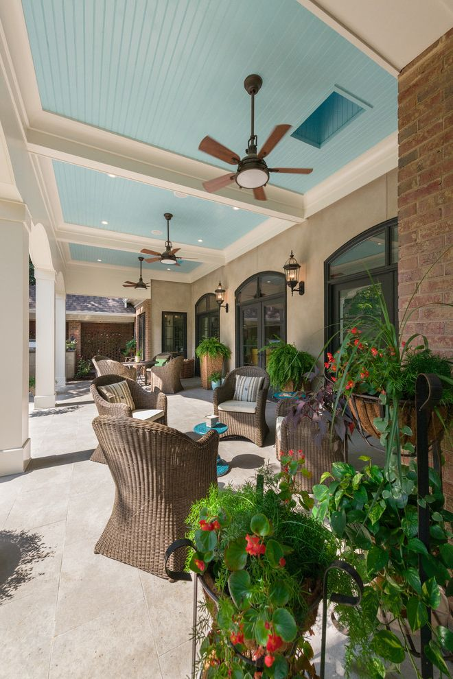 Costco Ceiling Fans   Traditional Patio Also Arched Doorways Beige Walls Blue Ceiling Box Beams Ceiling Fan Columns Light Blue Ceiling Painted Ceiling Patio Doors Potted Plants Recessed Lighting Tile Pavers Wicker Patio Furniture Woven Outdoor Funiture