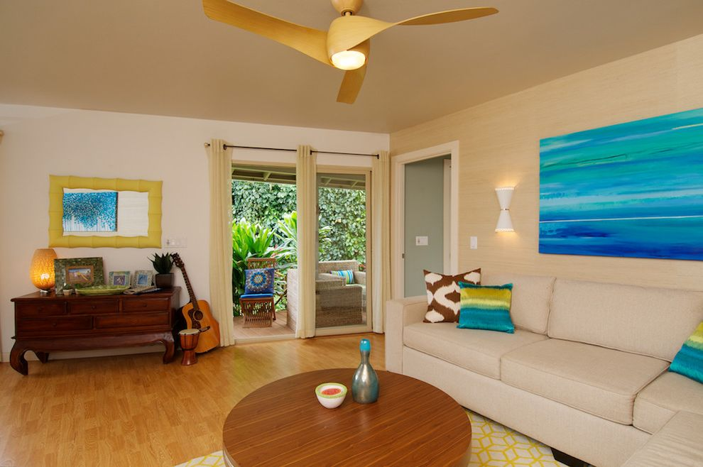 Costco Ceiling Fans with Tropical Living Room  and Beige Curtains Ceiling Fan Cream Sectional Cream Sofa Dark Wood Dresser Grass Cloth Wall Guitar Light Wood Floor Wall Sconce White Wall Wood Coffee Table Yellow Frame Mirror Yellow Patterned Rug