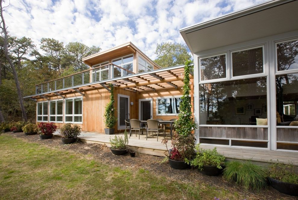 Deck Over Reviews   Midcentury Exterior  and Balcony Cape Cod Container Plant Eaves Handrail Mid Century Modern Cape Cod Outdoor Dining Overhang Patio Pergola Potted Plant Roof Deck Steel Cable Railing Trellis Truro