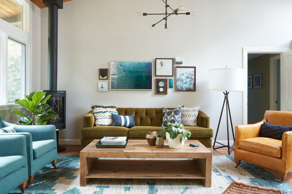 Edmond Furniture Gallery   Transitional Living Room  and Blue and White Rug Blue Armchair Gallery Wall Green Tufted Sofa Industrial Pendant Light Orange Armchair Reclaimed Wood Coffee Table