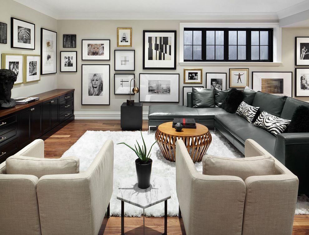 Edmond Furniture Gallery with Transitional Living Room Also Basement Living Room Beige Armchairs Black and White Black Sectional Sofa Framed Artwork Gallery Wall Hexagon Side Table Round Wood Coffee Table White Area Rug Zebra Print Pillows