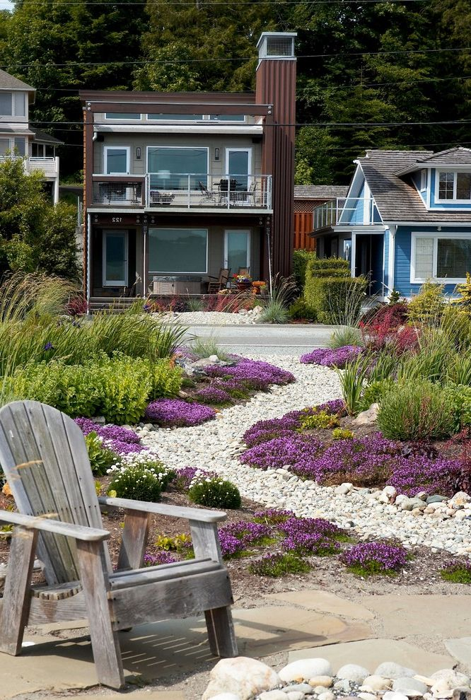 Fake Rock Covers with Beach Style Landscape  and Adirondack Chair Beach Coastal Curb Appeal Front Yard Grasses Gravel Ground Cover Naturalistic Patio Furniture Patio Pavers Purple Flowers Sinuous Path