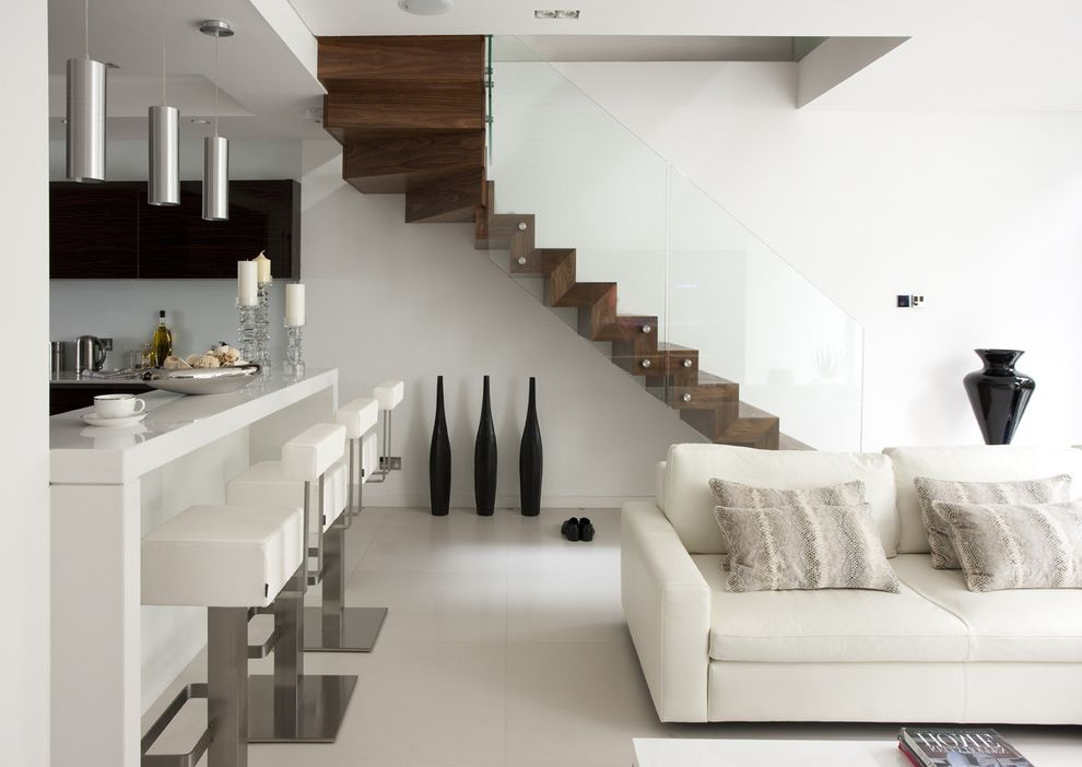Floating Stairs Cost   Modern Staircase Also Black Vase Breakfast Bar Glass Railing Metal Barstools Modern Barstools Pendant Light Throw Pillows White Floor White Sofa Wood Stairs