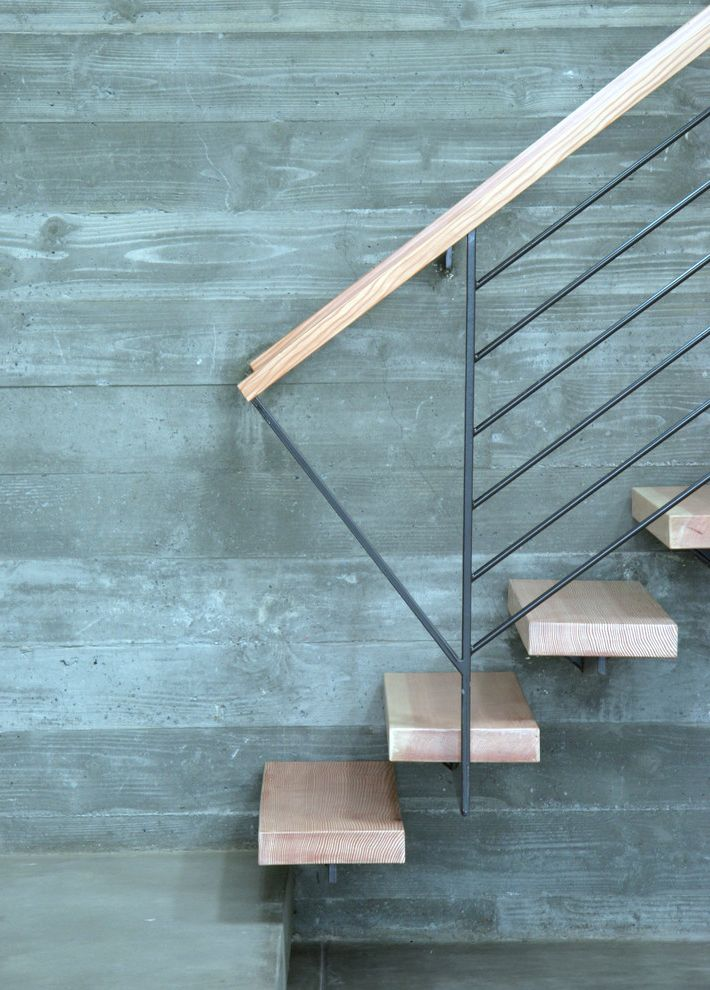 Floating Stairs Cost   Modern Staircase  and Board Formed Concrete Cantilevered Stairs Cantilevered Treads Concrete Floating Stairs Metal Railing Modern Railing Modern Staircase Uplighting Wood Wood Handrail Wood Treads