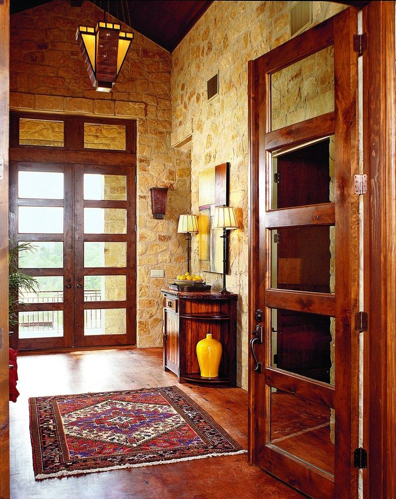Front Room Furnishing   Eclectic Entry Also Art Credenza Dark Stained Wood Entry Doors Entry Rug Oriental Pendant Lamp Stained Concrete Stone Wall Wall Sconce Yellow Accent