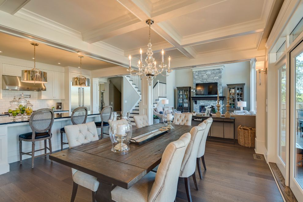 Front Room Furnishing with Traditional Dining Room  and Award Winning Builder Black Granite Chandelier Coffered Ceiling Upholstered Dining Chair White Cabinets White Trim Wood Dining Table