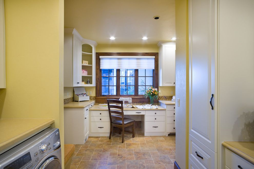 Front Room Furnishing with Traditional Laundry Room  and Beige Countertop Built in Desk Dark Wood Window Trim Dryer Laundry Room Sewing Machine Sewing Room Tile Backsplash Tile Floor Washer White Cabinet White Window Treatment Yellow Wall