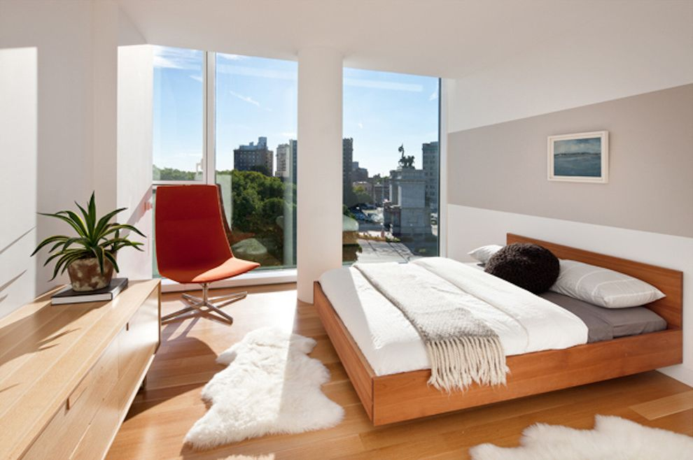 Fuzzy Rugs   Modern Bedroom Also Floating Bed Floor to Ceiling Windows Fur Rug Fuzzy Rug Light Wood Dresser Light Wood Floor Neutral Throw Orange Side Chair Striped Wall Wall Stripe White Pillar White Rug White Wall Wood Bed