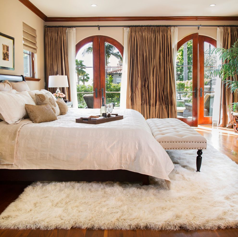 Fuzzy Rugs with Mediterranean Bedroom  and Arched Doorways Bedding Crown Moulding Drapery Faux Fur Rug Indoor Plants Shades Silk Curtains Tufted Bench White Bench White Rug White Shaggy Rug