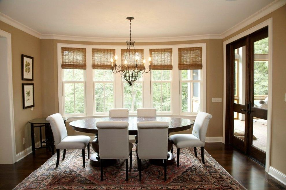 Home Depot Faux Wood Blinds with Traditional Dining Room  and Area Rug Chandelier Dark Floor Oriental Rug Upholstered Dining Chairs Wall Art Wall Decor White Wood Window Blinds Window Treatments Wood Flooring Wood Trim