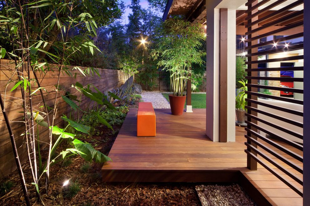 How Much to Build a Deck   Contemporary Landscape  and Bamboo Bench Deck E2 Homes Fence Horizontal Fence Ipe Deck Landscape Design Modern Design Orange Bench Outdoor Living Patio
