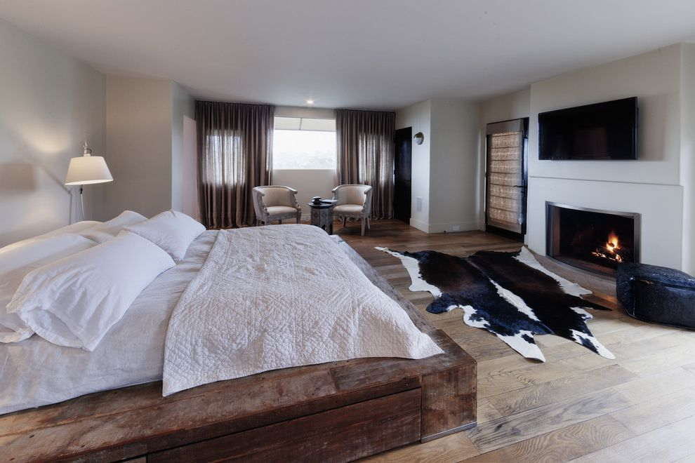 How Wide is a King Bed   Rustic Bedroom Also Cowhide Rug Curtains Drapes Master Bedroom Neutral Colors Platform Bed Reclaimed Wood Rustic Tv Above Fireplace Wall Mount Tv White Bedding Window Sheers Window Treatments Wood Flooring Wooden Bed