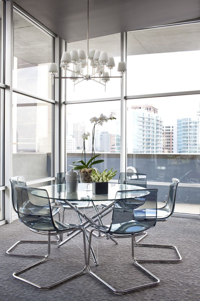 Ikea Twin Cities   Contemporary Dining Room  and Balcony Chandelier Glass Dining Table Glass Wall Gray Carpet Metal Window Trim Plastic Dining Chairs Terrace
