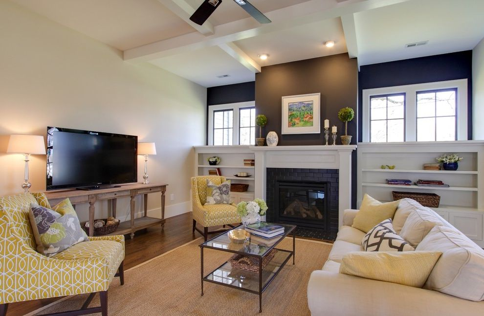 Living in Asheville Nc with Traditional Family Room Also Black Accent Wall Black Brick Fireplace Surround Built in Shelves Patterned Chairs Simple Baseboard Small Table Lamps Topiaries Tv Stand Upholstered Chairs White Fireplace Mantel