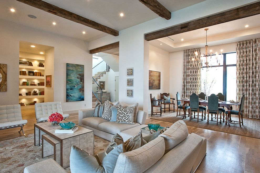 Living in Asheville Nc with Traditional Living Room  and Area Rug Beige Dining Area Fireplace Patio Seating Area Sectional Slant Ceilings Stone Wall Tall Windows White Leather Tufted Upholstery Wood Beams Wood Floors