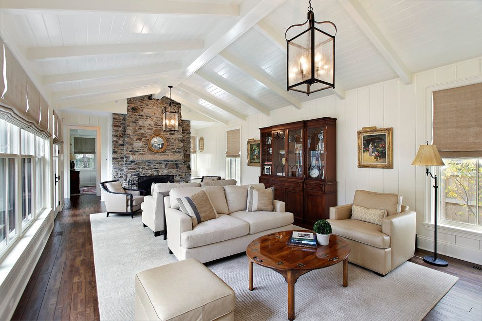 Living Spaces Mission Valley   Traditional Living Room  and Cathedral Ceiling Chandelier Chimney Coffee Table Cottage Courtyard Fireplace French Windows Lantern Panel Paneling Stone Fireplace White White Rug White Sofa Windows Wood Floor