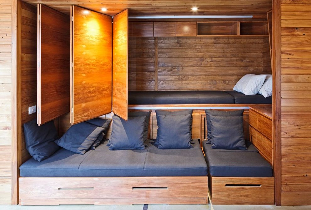 Lowes Hawaii with Beach Style Bedroom  and Bach Bifold Door Built in Storage Cedar Cladding Concrete Floor Concrete Table Eco Home First Light House Flexible Pine Prefab Rimu Solar Decathlon Solar Panels Sustainable Design Wool Zero Energy House