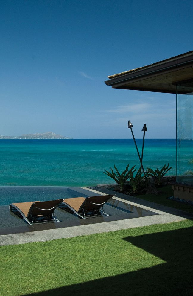 Lowes Hawaii with Tropical Pool  and Chaise Lounge Corner Window Disappearing Edge Pool Glass Wall Grass Hawaii Infinity Pool Lawn Ocean Overhang Tiki Torches Turf View Waterfront Zero Edge Pool