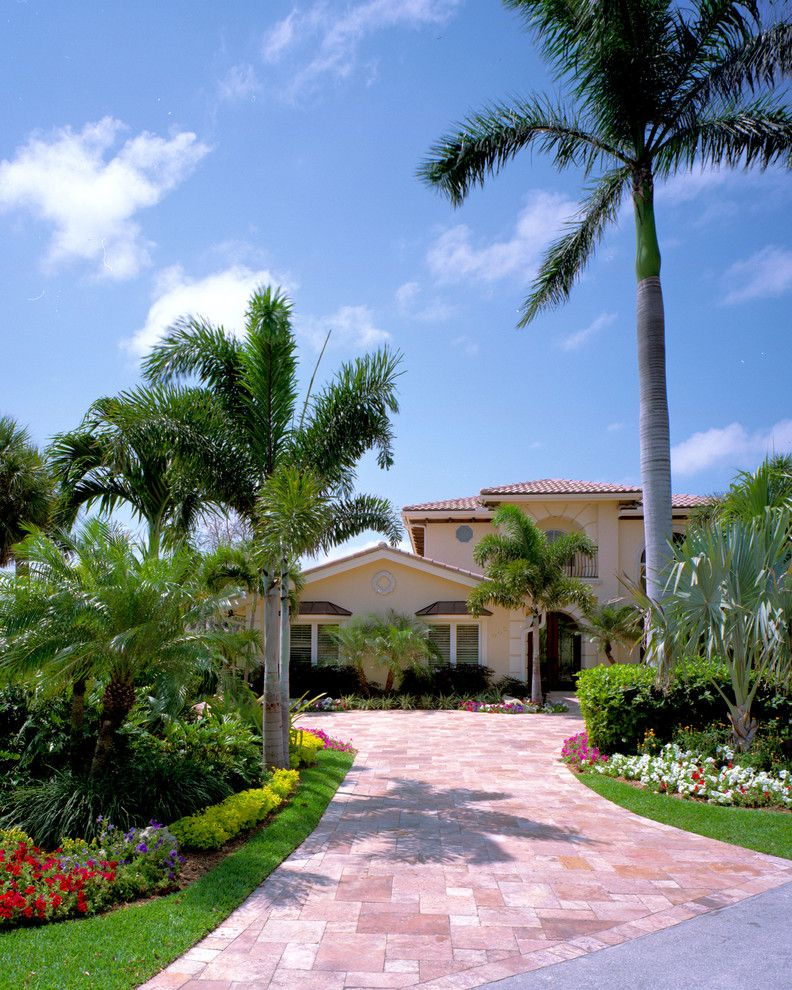 Lowes Palm Coast with Tropical Landscape Also Bay Window Ideas Clay Tile Roof Flower Beds Front Yard Landscaping Mediterranean Exterior Ideas Mediterranean Style Mediterranean Style Exterior Stone Driveway Stone Driveway Ideas Stone Paved Driveway