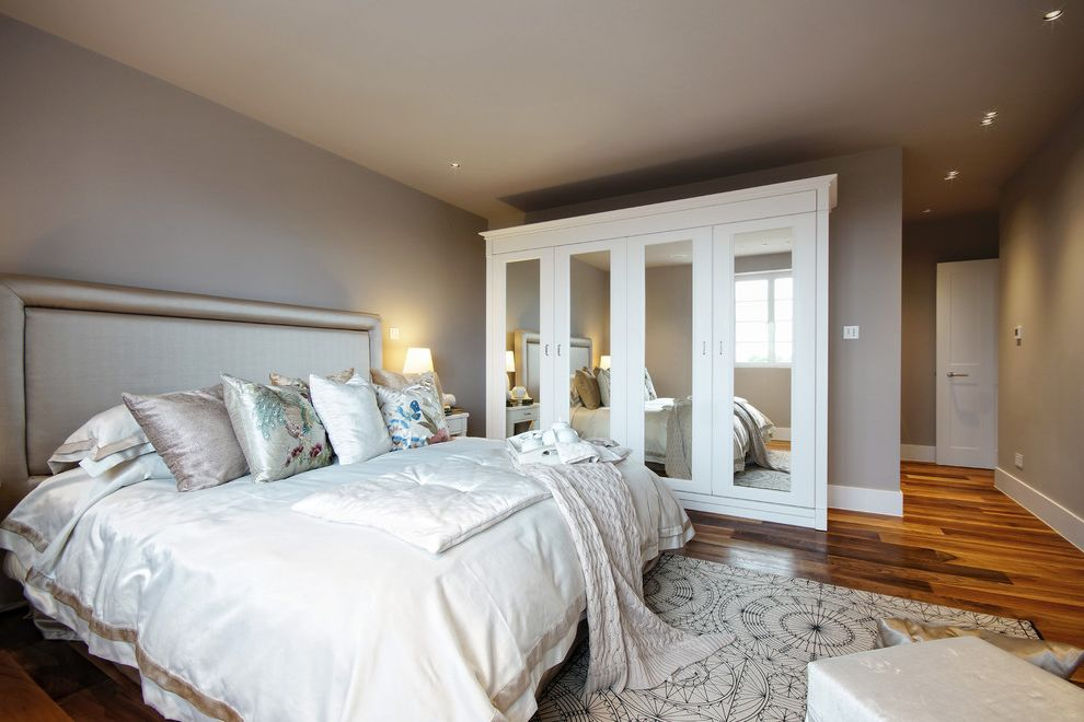 Luxe Birmingham with Transitional Bedroom Also Black and White Rug Luxe Bedding Luxury Bedroom Medium Hardwood Floors Mirror Closet Doors Recessed Lighting Satin Headboard Satin Sheets Taupe Walls