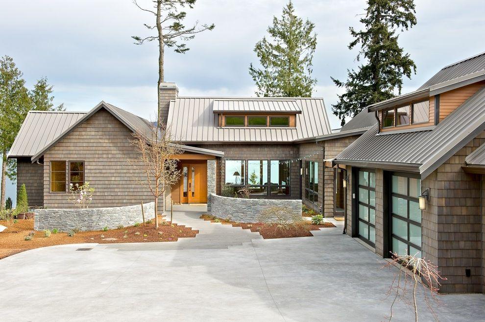 Metal Roof vs Shingles   Beach Style Exterior  and Dormer Windows Glass Garage Doors Outdoor Lighting Shingle Siding Standing Seam Metal Roof Stone Wall