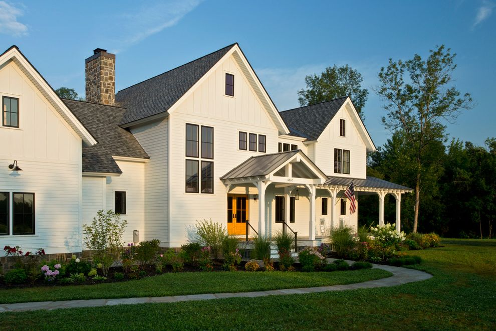 Metal Roof vs Shingles with Farmhouse Exterior  and Albany Backsplash Barn Barn Doors Board and Batten Mantle Millwork Modern Farmhouse Porch Portico Saratoga Springs Timber Frame White Kitchen