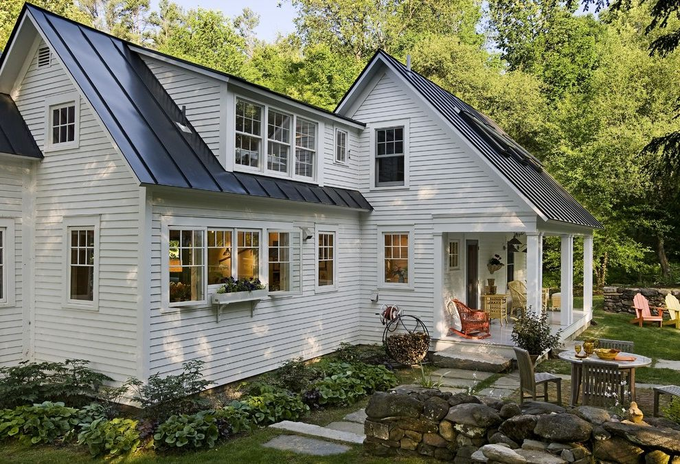 Metal Roof vs Shingles with Farmhouse Exterior  and Black Tin Roof Garden Garden Furniture Lawn Outdoor Lamp Porch Stone Paths Stone Step Stone Wall Tin Roof White Wood House Wicker Chairs Wicker Furniture Wooden Garden Furniture