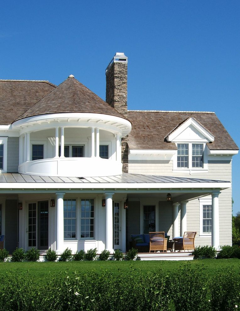 Metal Roof vs Shingles with Victorian Exterior  and Cape Cod Style Columns Dormer Windows Grass Hedge Lanterns Lawn Metal Roof Outdoor Lighting Patio Furniture Porch Shake Roof Standing Seam Roof Tower Turf Turret White Wood Wood Siding Wood Trim