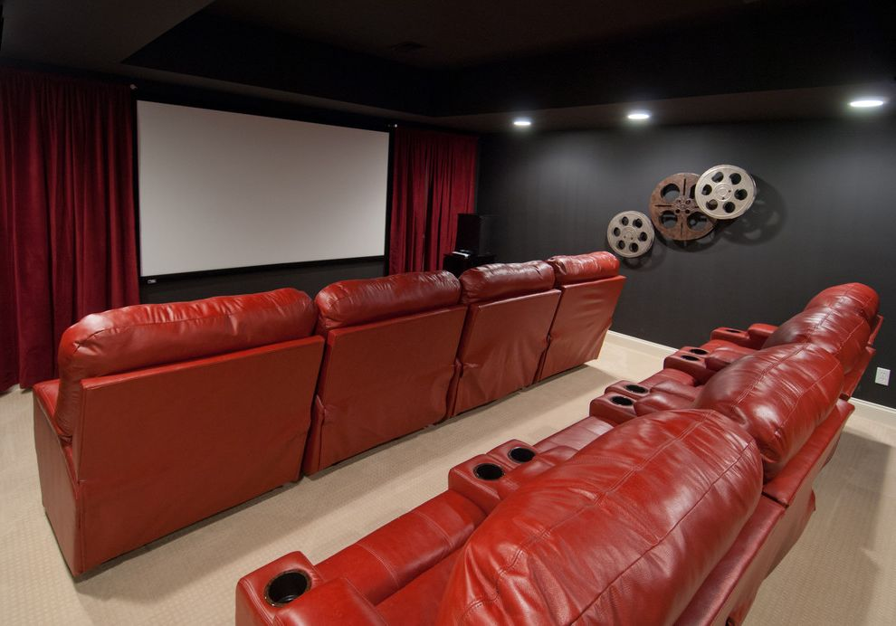 Old Mill Theater with Traditional Home Theater  and Black Walls Cinema Room Film Reels Home Theater Large Screen Media Room Red Armchairs Red Couch Red Curtains Red Velvet Curtains Theater Couch Theater Room Theater Seating