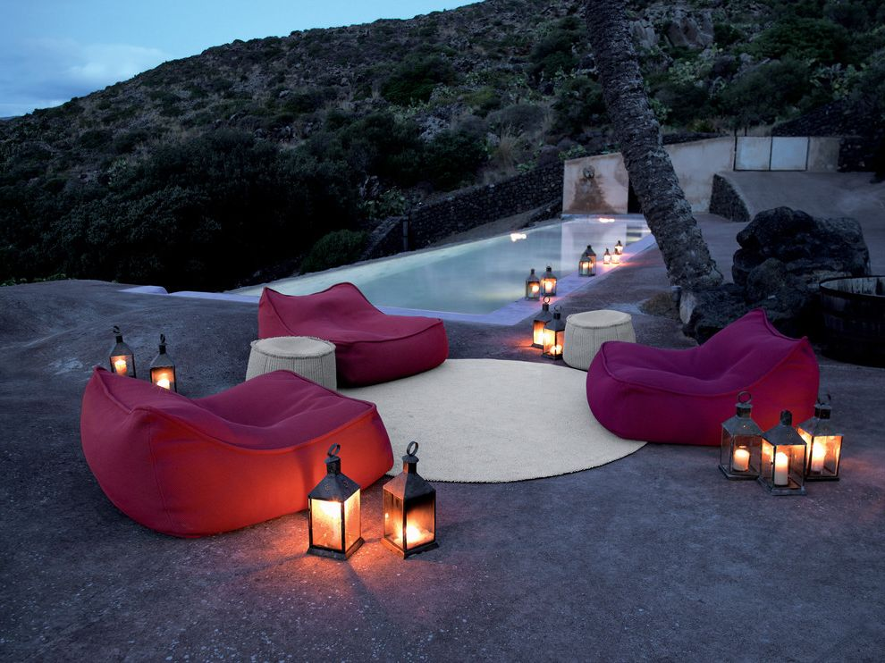 Oversized Bean Bag Chairs with Tropical Pool Also Bean Bag Chairs Candles Hillside Infinity Pool Lanterns Lap Pool Lounge Seating Modern Furniture Outdoor Cushions Outdoor Lighting Outdoor Rug Palm Trees Patio Furniture Pool Pool Lights Slope