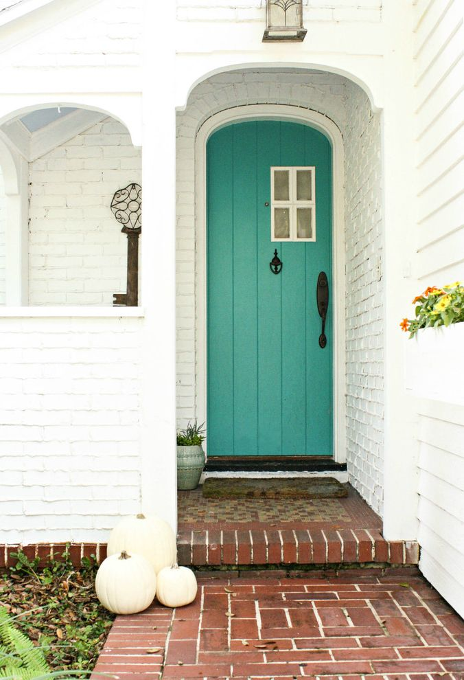 Red Door Spa Chicago   Shabby Chic Style Entry  and Aqua Arched Doorway Beach Cottage Blue Door Brick Path Covered Entry Flower Box House Numbers Key Artwork Lantern Lap Siding Large Key My Houzz Painted Brick Porch White Pumpkins