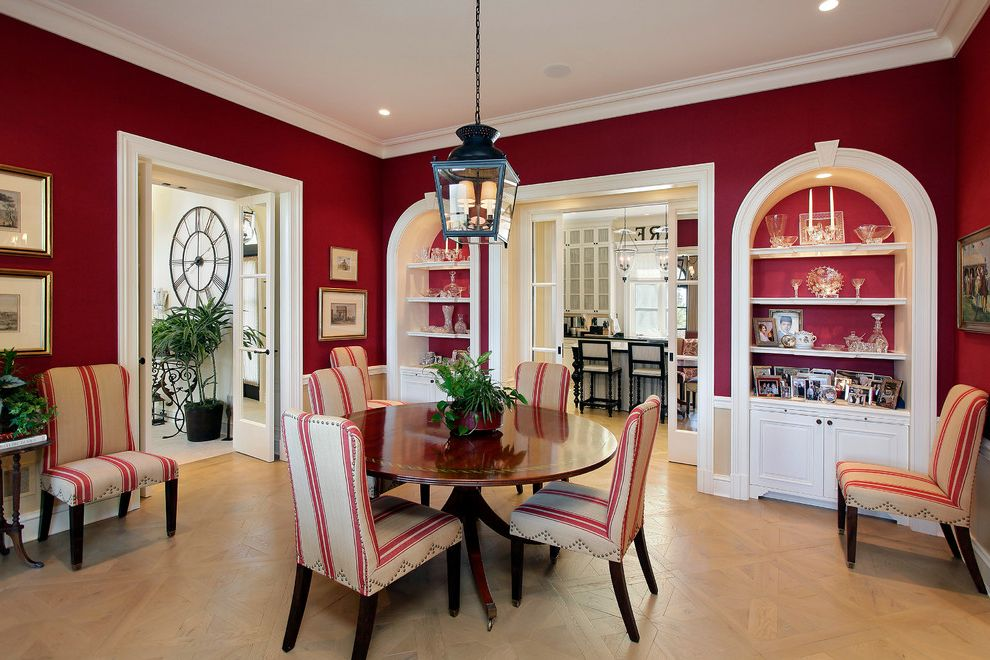 Red Door Spa Chicago with Mediterranean Dining Room Also Arch Breakfast Room Built in Cabinets Built in Shelves Deep Red Walls Iron Lantern Red Stripe Round Wood Dining Table Upholstered Dining Chairs White Trim