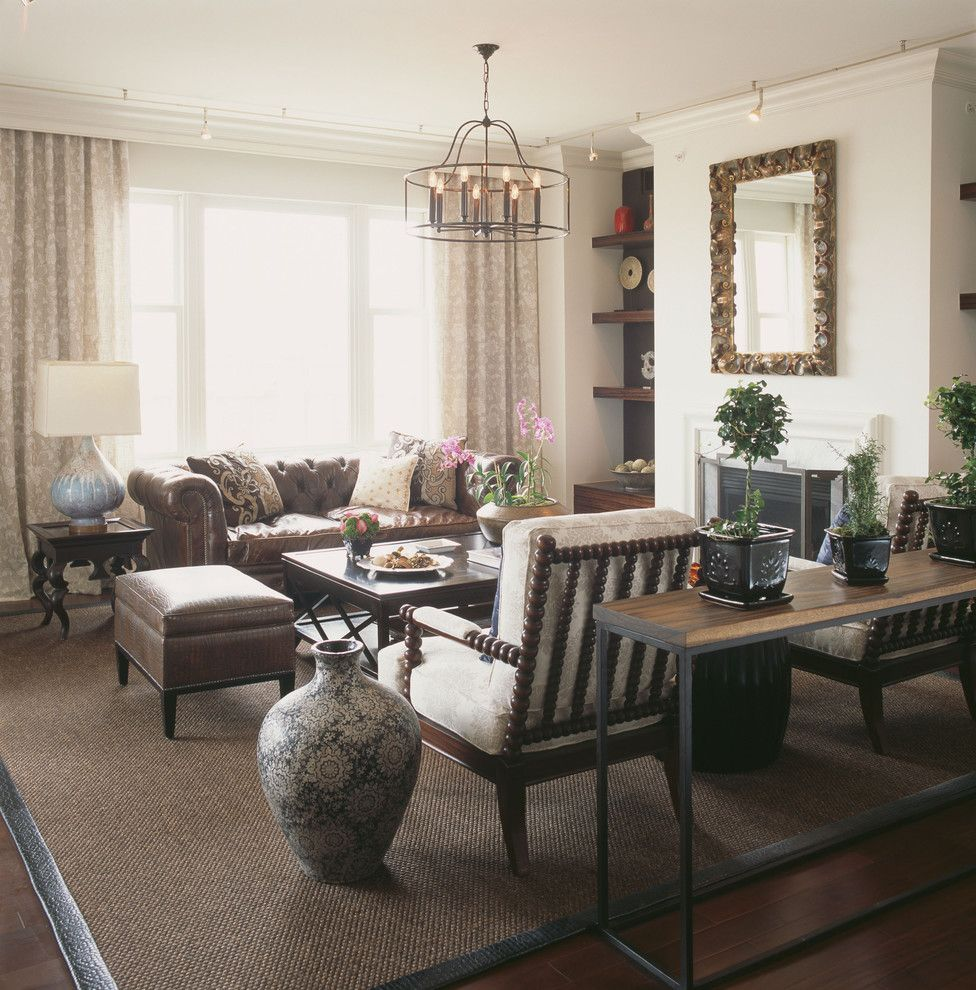 Ritz Carlton Baltimore with Contemporary Family Room Also Area Rug Built in Shelves Chesterfield Sofa Curtains Drapes Drum Chandelier Natural Rug Neutral Colors Spindle Armchair Tufted Leather Sofa Window Treatments