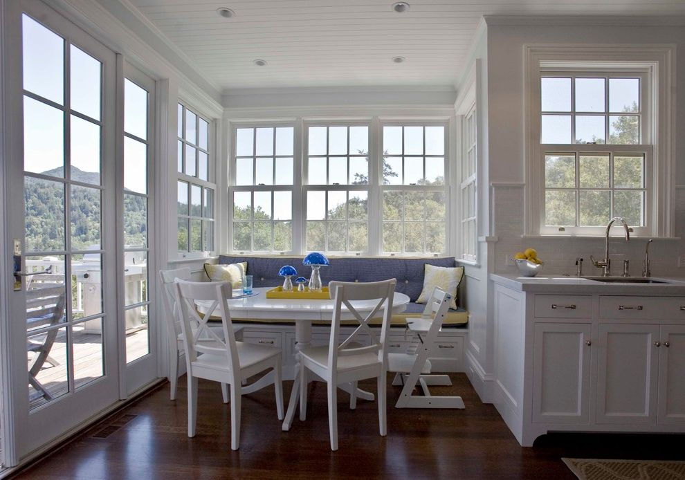 Ross Modesto Ca   Traditional Kitchen  and Blue Breakfast Nook Built in Bench Seat Clean Dark Wood Floor Deck Double Hung Windows French Doors Kitchen Navy Open Pedestal Table Round Table Tile Backsplash White White Cabinets Window Seat Yellow